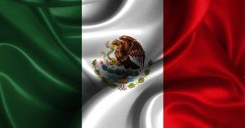 Realistic flag of Mexico on the wavy surface of fabric. This flag can be used in design